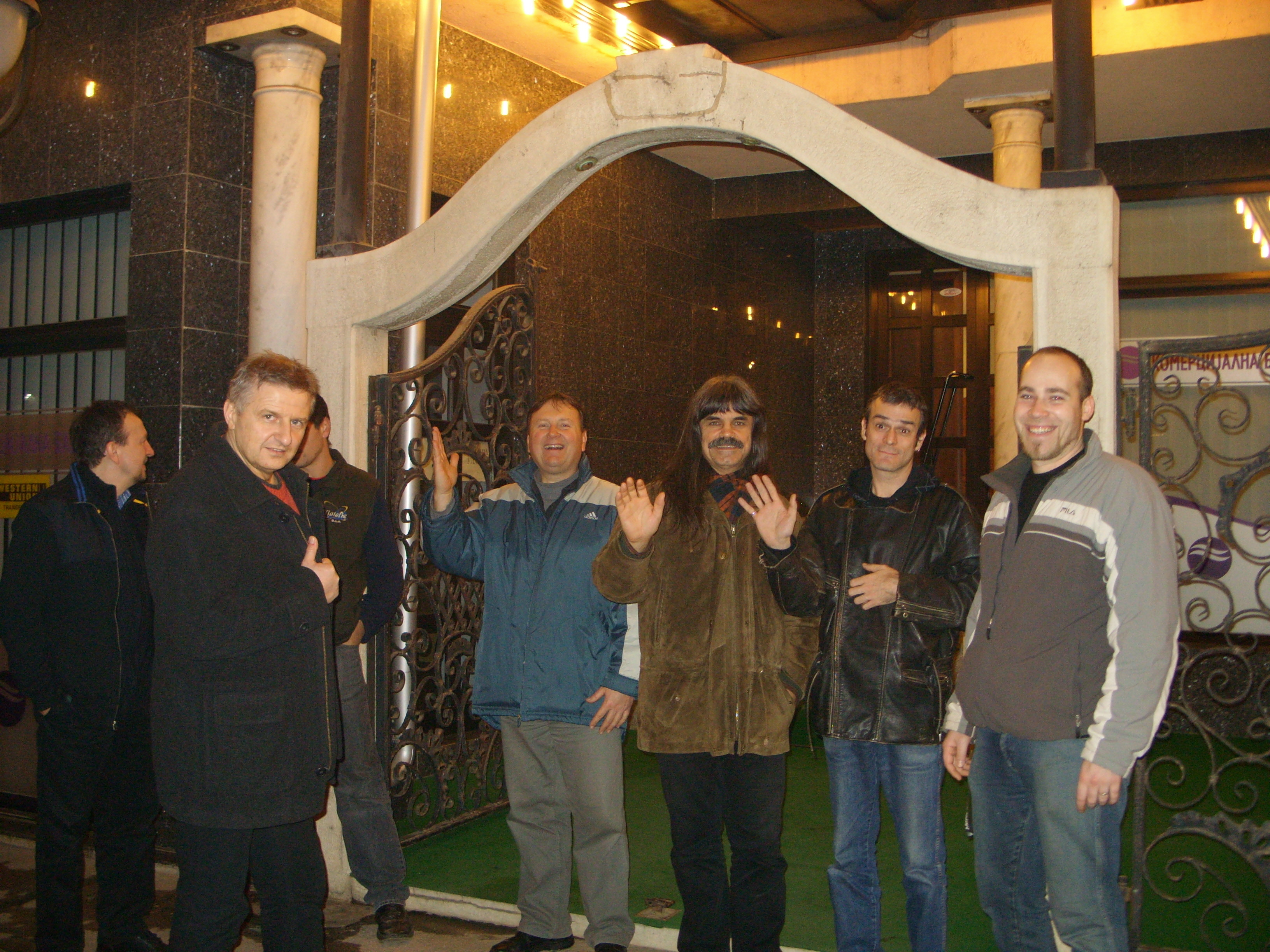 Group members with the staff in front of the Hotel
